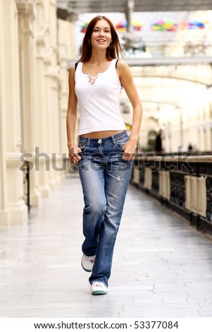 Full length portrait of a beautiful woman - stock photo