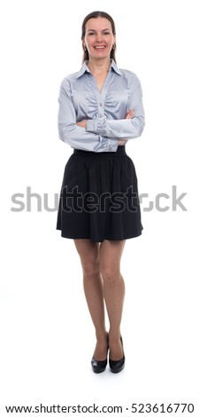 Full length portrait of a beautiful young happy woman standing over white background