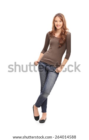 Full length portrait of a beautiful young woman leaning against a wall isolated on white background - stock photo
