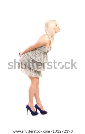 Full length portrait of a blond woman wearing dress giving kisses isolated against white background - stock photo