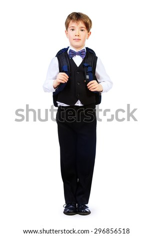 Full length portrait of a boy in a suit standing with schoolbag. Fashion kids. Education. Isolated over white.  - stock photo