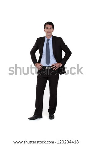 Full-length portrait of a businessman - stock photo