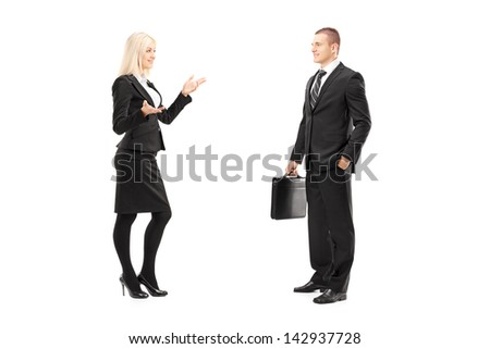 Full length portrait of a businessman and businesswoman talking, isolated on white background