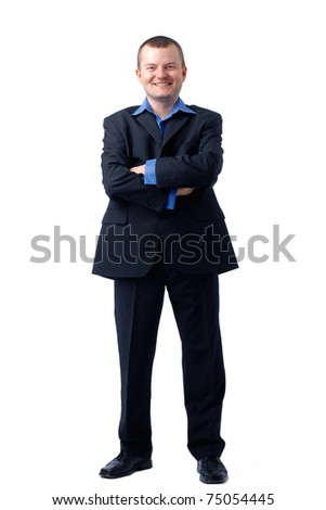 Full length portrait of a businessman, his hands folded