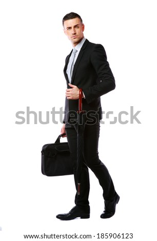 Full length portrait of a businessman standing with laptop bag and umbrella over white background