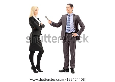 Full length portrait of a businesswoman and male reporter having an interview, isolated on white background - stock photo