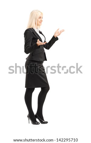 Full length portrait of a businesswoman gesturing with hands, standing in  profile, isolated on white - stock photo