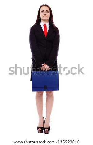 Full length portrait of a businesswoman holding a briefcase isolated on white background