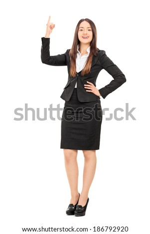 Full length portrait of a businesswoman holding her finger up isolated on white background