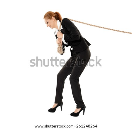 Full length portrait of a businesswoman pulling a rope isolated on white background - stock photo