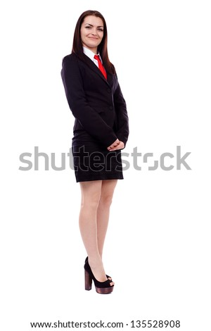 Full length portrait of a businesswoman standing isolated on white background
