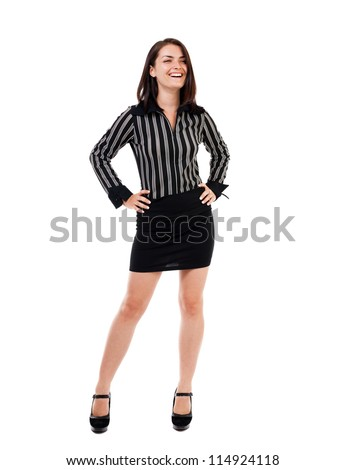 Full length portrait of a businesswoman standing with hands on hips