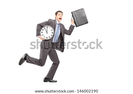 Full length portrait of a busy businessperson running late with wall clock and briefcase isolated on white background - stock photo