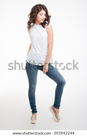Full length portrait of a casual beautiful woman posing isolated on a white background