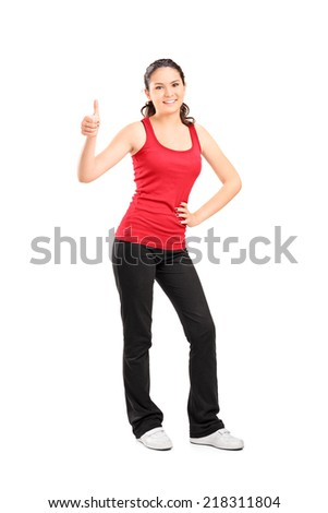Full length portrait of a casual girl giving a thumb up isolated on white background