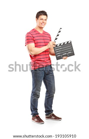 Full length portrait of a casual man holding an open movie clap isolated on white background