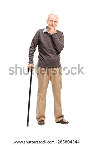 Full length portrait of a casual senior with a black wooden cane posing isolated on white background - stock photo