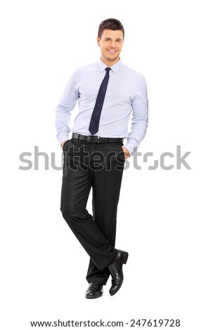 Full length portrait of a casual young businessman leaning against a wall isolated on white background - stock photo