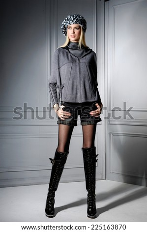 Full length portrait of a casual young fashion model posing  - stock photo