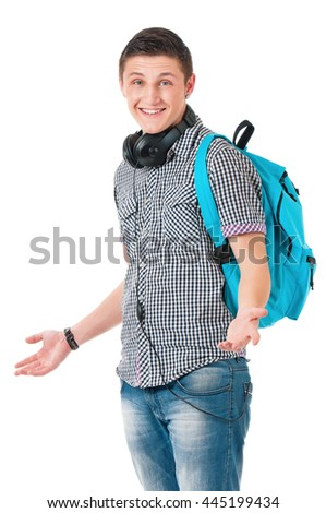 Full length portrait of a caucasian guy student of college or university with backpack. Young casual male presenting something on his face against white background. - stock photo