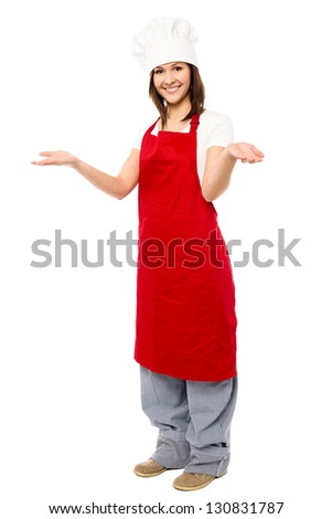 Full length portrait of a charming young female chef isolated on white.