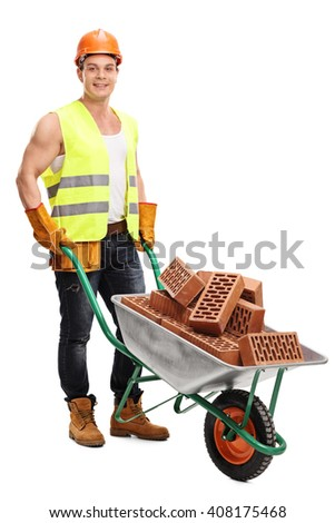 Full length portrait of a cheerful construction worker posing with a wheelbarrow full of bricks isolated on white background - stock photo