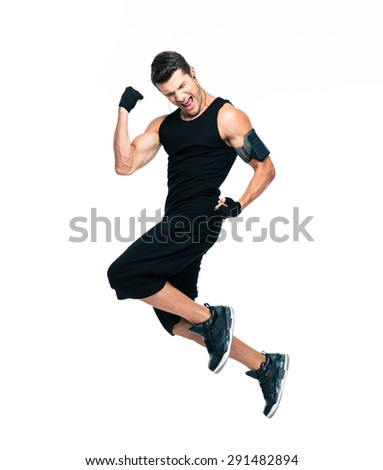 Full length portrait of a cheerful fitness man jumping isolated on a white background - stock photo