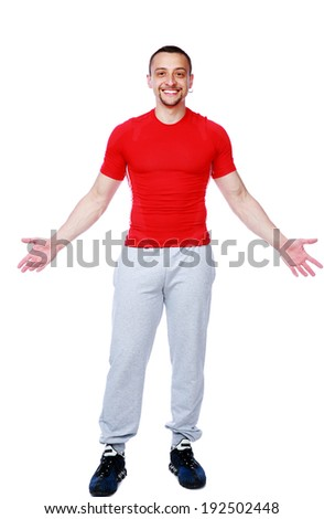 Full length portrait of a cheerful man standing over white background - stock photo