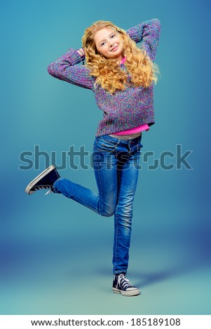 Full length portrait of a cheerful ten years girl. - stock photo