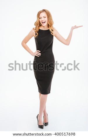 Full length portrait of a cheerful woman holding copyspace on the palm isolated on a white background - stock photo