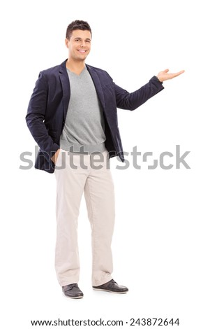 Full length portrait of a cheerful young man gesturing with his hand isolated on white background - stock photo