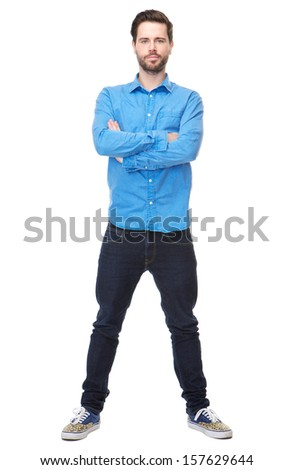 Full length portrait of a confident young man with beard standing on isolated white background with arms crossed - stock photo