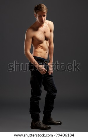 Full length portrait of a confident young men, on grey background - stock photo