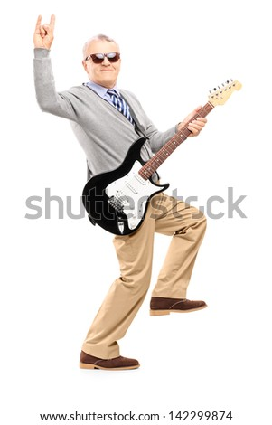 Full length portrait of a cool middle aged man with an electric guitar, isolated on white background - stock photo