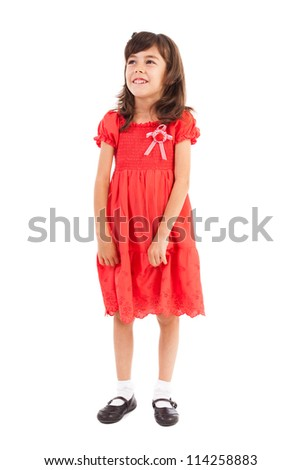 Full length portrait of a cute little girl in a dress isolated on white