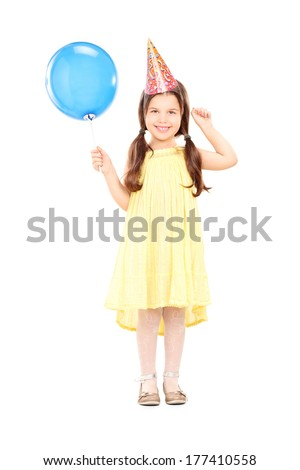 Full length portrait of a cute little girl with party hat holding balloon isolated on white background - stock photo
