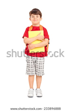 Full length portrait of a cute schoolboy holding books isolated on white background