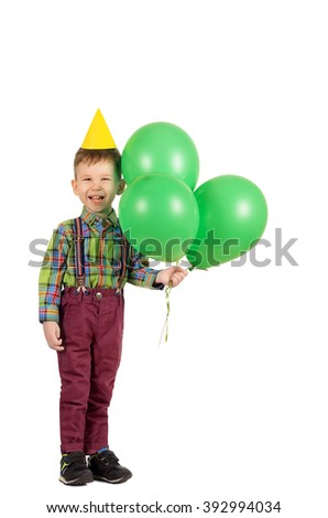 Full length portrait of a cute smiling little boy with birthday cap and balloons isolated on white background - stock photo