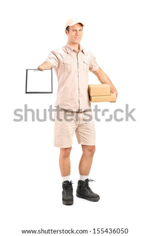 Full length portrait of a delivery boy holding a packet and giving a clipboard for signature isolated on white background