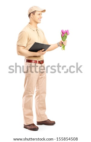 Full length portrait of a delivery person holding a clipboard and bunch of flowers isolated on white background - stock photo