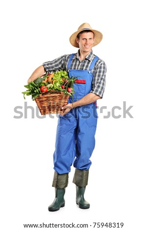 Full length portrait of a farmer holding a basket full of vegetables isolated on white background - stock photo