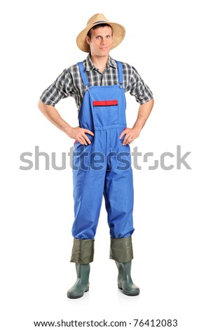 Full length portrait of a farmer posing isolated on white background