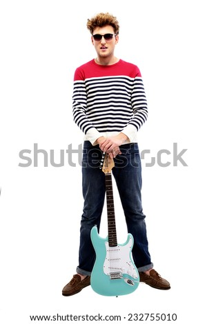 Full length portrait of a fashion man standing with guitar - stock photo