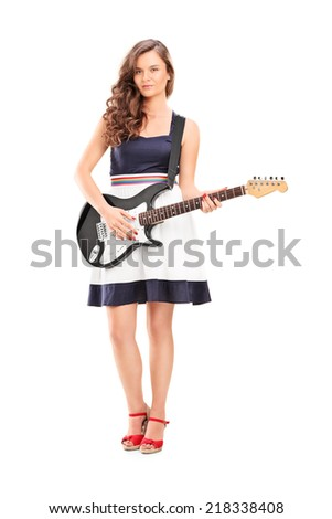 Full length portrait of a fashionable woman holding an electric guitar isolated on white background - stock photo