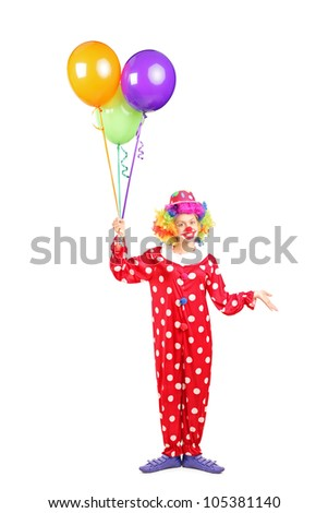 Full length portrait of a female clown, happy joyful expression on face, with a bunch of balloons isolated on white background - stock photo
