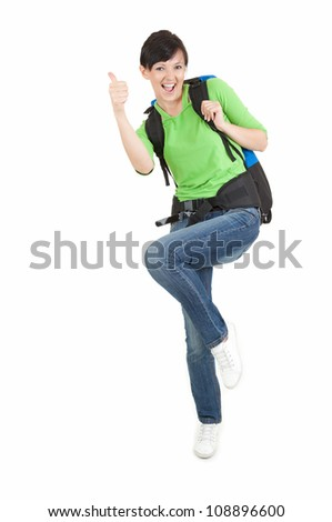 full length portrait of a female hiker with backpack giving a thumb up, white background