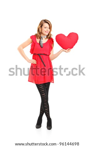 Full length portrait of a female holding a red heart shaped pillow isolated on white background - stock photo