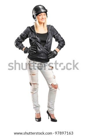 Full length portrait of a female motorcycler with helmet isolated on white background