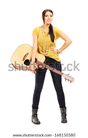 Full length portrait of a female musician holding an acoustic guitar isolated on white background - stock photo