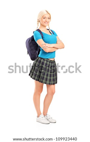 Full length portrait of a female student standing with crossed hands, isolated on white background - stock photo